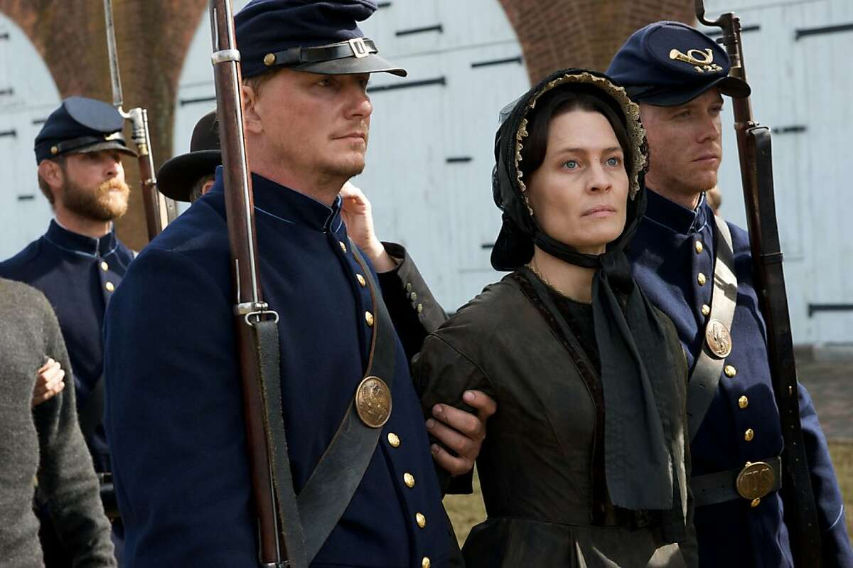 In this film publicity image released by Roadside Attractions, Robin Wright, left, portrays Mary Surratt in a scene from
