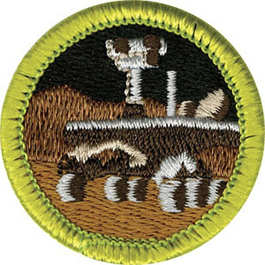 This photo released April 7, 2011 by the Boy Scouts of America shows a new Robotics merit badge, which depicts NASA's Mars rover. The badge will be unveiled next week as part of its efforts to emphasize science, technology, engineering and math. (AP Photo/Boy Scouts of America)   NO SALES Photo: Boy Scouts Of America, Associated Press