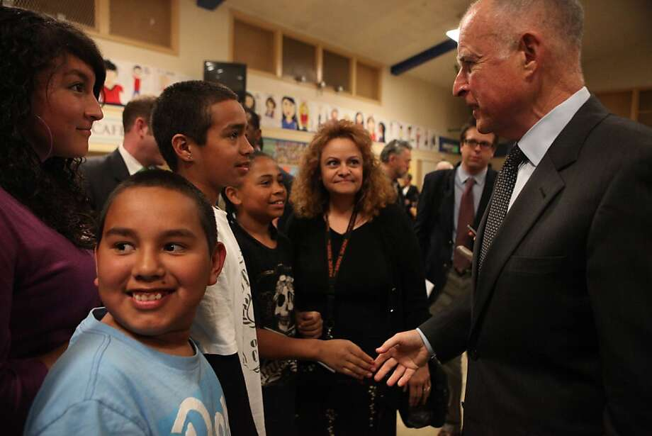 Victor Gonzalez (third from left), 13, shakes Governor Jerry Brown hand after a town hall meeting at Van Buren Elementary School on Thursday, April 14,, 2011 in Stockton, Calif. Photo: Lea Suzuki, The Chronicle