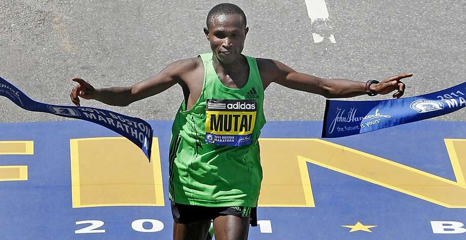 Geoffrey Mutai of Kenya breaks the tape to win the men's division at the finish line of the 115th Boston Marathon in Boston, Monday, April 18, 2011. Photo: Charles Krupa, AP
