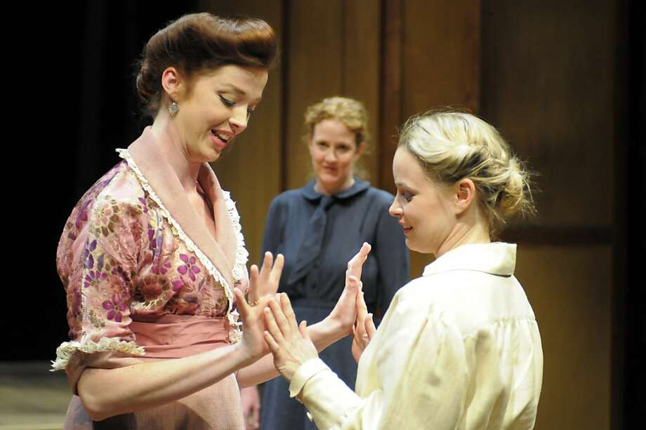 "New sister-in-law Natasha (Emily Kitchens, left) cloaks hurtful words in a smile to Irina (Heather Wood, right) as Olga (Wendy Rich Stetson) watches in  Chekhov's ""Three Sisters"" at Berkeley Repertory Theatre Photo: Mellopix.com"