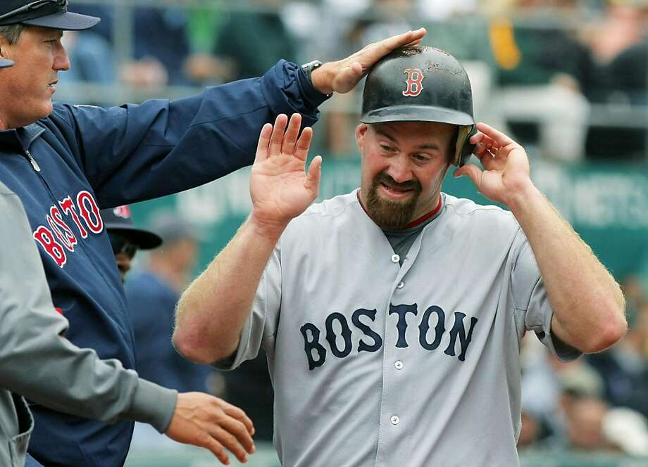 Boston Red Sox Kevin Youkilis is greeted by teammates after hitting a solo home run off Oakland Athletics' starting pitcher Gio Gonzalez in the fourth inning Wednesday, April 20, 2011 in Oakland, California. Photo: Lance Iversen, The Chronicle