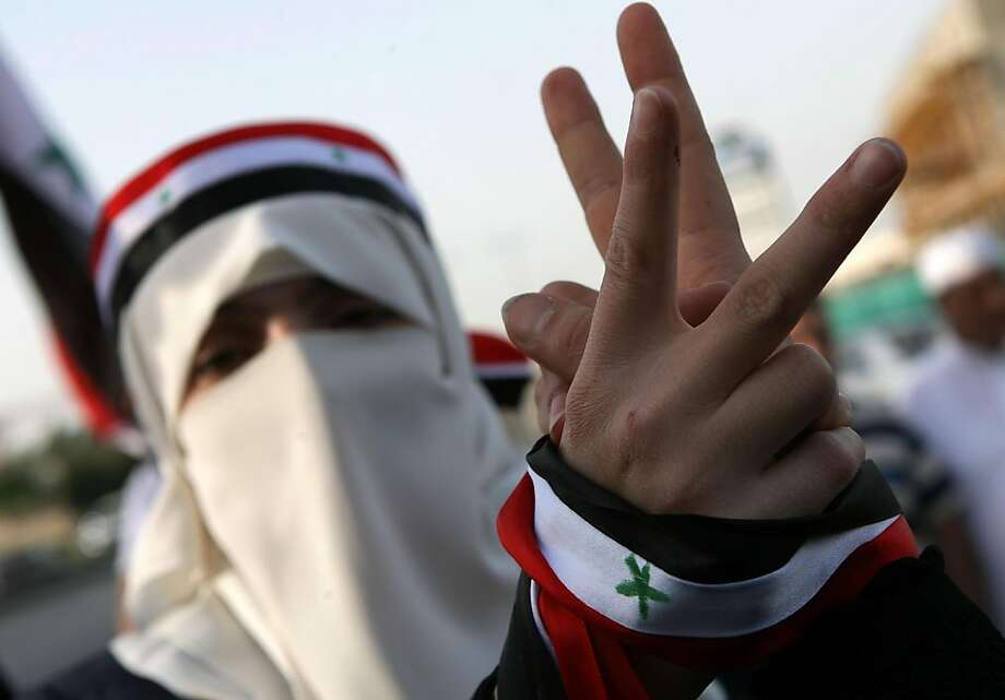 A Syrian protester flashes the victory sign during a protest calling for President Bashar Assad to step down in front of Syrian embassy in Amman, Jordan, Sunday, April 17, 2011. The demonstrations come despite promises by Assad to end the widely despisedstate of emergency rule by next week at the latest, and implement other reforms following more than a month of unprecedented, and growing, demonstrations. Photo: Nader Daoud, AP