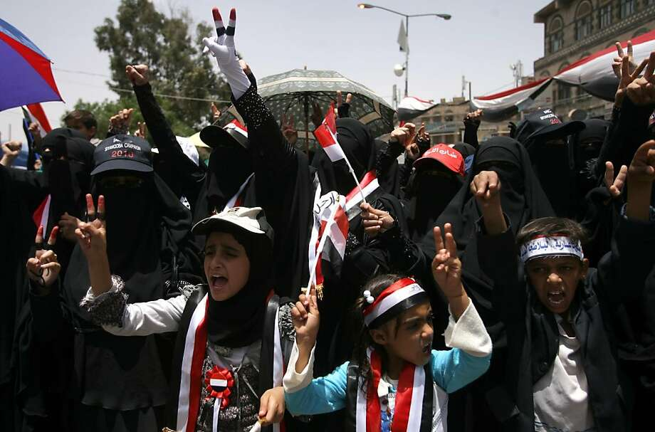 TOPSHOTS Yemeni protesters flash the V-sign during a demonstration calling for president Ali Abdullah Saleh's ouster, in Sanaa, on April 17, 2011. The Yemeni opposition was seeking details from Gulf foreign ministers who were meeting today in Riyadh on aplan for Saleh's departure, an opposition leader said. Photo: Mohammed Huwais, AFP/Getty Images
