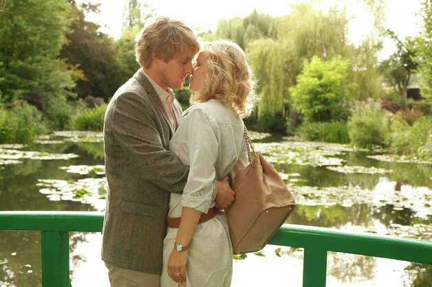 "Owen Wilson plaus Gil and Rachel McAdams portrays Inez in the Woody Allen film ""Midnght in Paris,"" which is out on video this month. Photo: Courtesy Of Sony Pictures Classics"