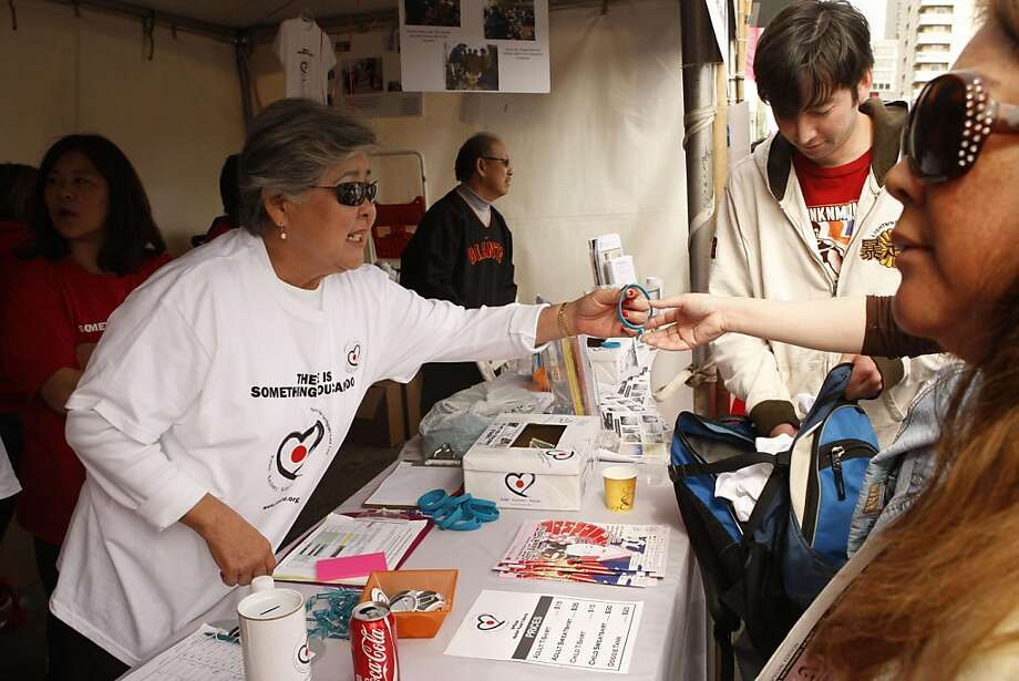 Lois Hunter sells bracelets at the Japanese Cultural Center's 'Northern Japan Earthquake Relief Fund' booth during the Northern California Cherry Blossom Festival in San Francisco Calif, on Friday, April 16, 2011. Photo: Alex Washburn, The Chronicle