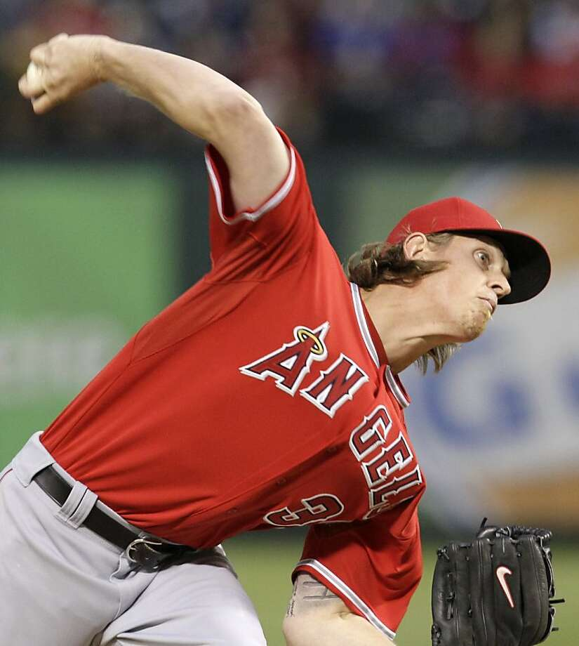 Los Angeles Angels' Jered Weaver (36) delivers to the Texas Rangers in the first inning of a baseball game on Wednesday, April 20, 2011, in Arlington, Texas. Photo: Tony Gutierrez, AP