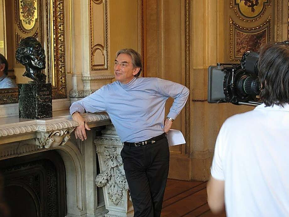 "Michael Tilson Thomas with the bust of Gustav Mahler at the Vienna Opera House during the filming of ""Keeping Score"" Photo: Courtesy SF Symphony"