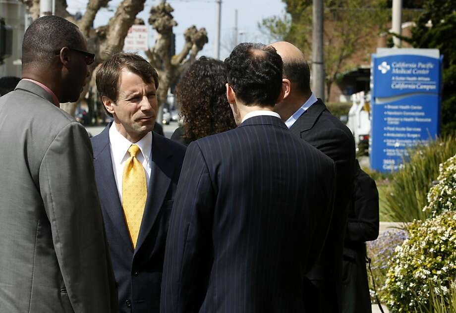 State Insurance Commissioner Dave Jones (second from left) confers with members of his staff and an attorney before he announced plans to intervene in a whistlblower lawsuit against Sutter Hospitals in San Francisco, Calif. on Wednesday, April 13, 2011, in a case where the health provider allegedly overbilled for anesthesia services. Photo: Paul Chinn, The Chronicle