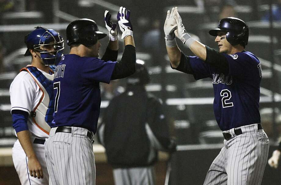 Colorado Rockies' Troy Tulowitzki (2) celebrates with teammate Seth Smith (7) as New York Mets catcher Josh Thole, left, looks on after Tulowitzki hit a three-run home run during the fifth inning of a baseball game on Wednesday, April 13, 2011, at CitiField in New York. Photo: Frank Franklin II, AP