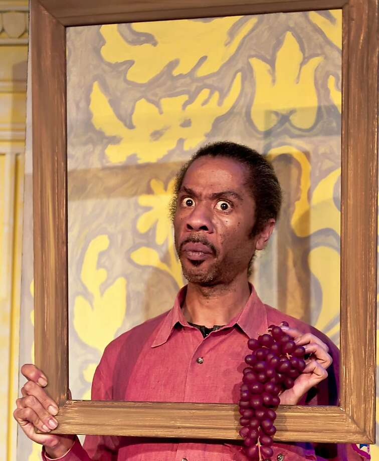 1 - Sir Andrew Aguecheek (Martin Grizzell) ?hides? behind a picture frame in Malvolio?s bedroom in African-American Shakespeare Company?s production of Twelfth Night. Photo: Lance Huntley
