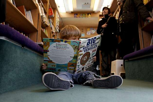 Hector Naselaris, 2-years-old, explores the books inside, as the San Francisco Public Library held an open house in honor of National Bookmobile Day outside the Main Library to display their bookmobiles, on Wednesday April 13, 2011, in San Francisco, Ca. Photo: Michael Macor, The Chronicle