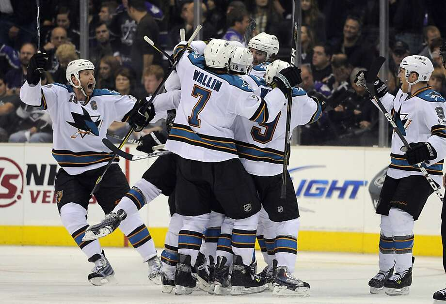 Members of the San Jose Sharks celebrate a game-winning goal by right wing Devin Setoguchi during an overtime period in Game 3 of a first-round NHL Stanley Cup playoffs hockey series against the Los Angeles Kings, Tuesday, April 19, 2011, in Los Angeles.The Sharks won 6-5. Photo: Mark J. Terrill, AP