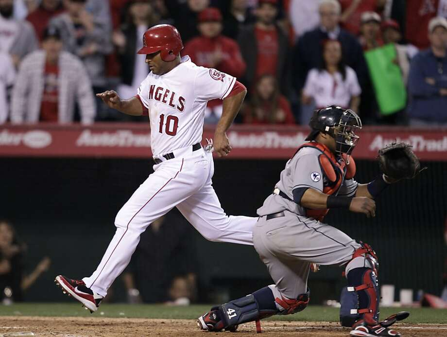 Los Angeles Angels' Vernon Wells (10) scores on a sacrifice by teammate Jeff Mathis to win a baseball game against the Cleveland Indians in the 12th inning in Anaheim, Calif., Wednesday, April 13, 2011. The Angels won 4-3. Photo: Jae C. Hong, AP