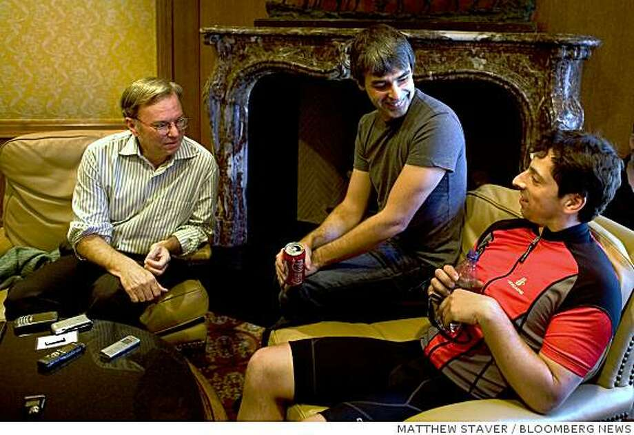 Google Inc. executives, from left, Eric Schmidt, chairman and chief executive officer, and co-founders Larry Page and Sergey Brin, speak with members of the media during the 26th annual Allen & Co. Media and Technology Conference in Sun Valley, Idaho, U.S., on Thursday, July 10, 2008. Schmidt said the company's advertising agreement with Yahoo! Inc. is more valuable than perceived. Google hopes the deal will help thwart Microsoft Corp.'s efforts to acquire Yahoo, saying that an independent Yahoo is better for competition. Photographer: Matthew Staver/Bloomberg News Photo: MATTHEW STAVER, BLOOMBERG NEWS