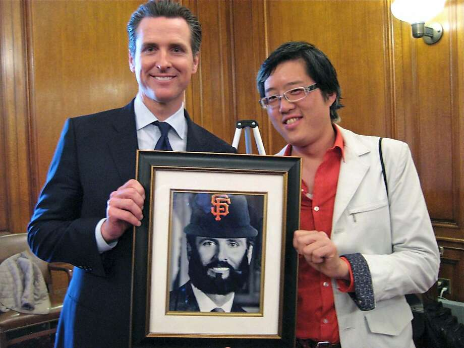 Lt. Governor Gavin Newsom (at left) with a photo-shopped version of his offical Mayoral portrait by Orange Photography co-founder Gene X. Hwang at City Hall. April 2011. By Catherine Bigelow. Photo: Catherine Bigelow, Special To The Chronicle