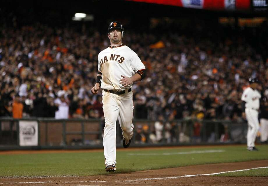 San Francisco Giants' Aaron Rowand scores to tie the game up during the 5th inning as the San Francisco Giants take on the Los Angeles Dodgers at AT&T Park in San Francisco, Calif., on Tuesday, April 12, 2011. Photo: Thomas Levinson, The Chronicle
