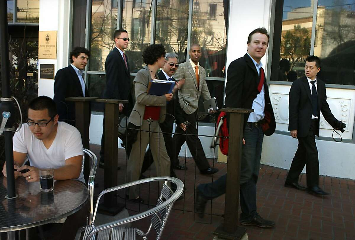 Sean Garrett (second to right) of Twitter, is given a tour of the central Market St. area with mayor Ed Lee in San Francisco, Calif., on Wednesday, April 6, 2011. Jeffrey Huynh (left) having a coffee outside of the Market Street Grill.