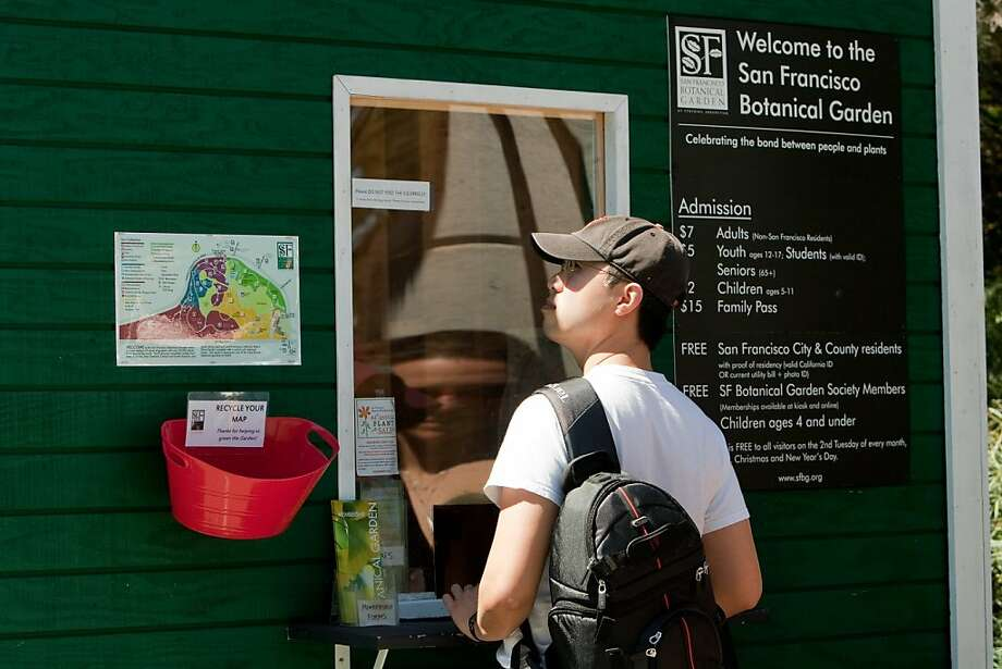 Chris Gee of Alameda pays the entrance fee of 7 dollars   at the entrance to the Botanical Gardens in Golden Gate Park on April 4, 2011 in San Francisco, Calif.  Photograph by David Paul Morris/Special to the Chronicle Photo: David Paul Morris, Special To The Chronicle