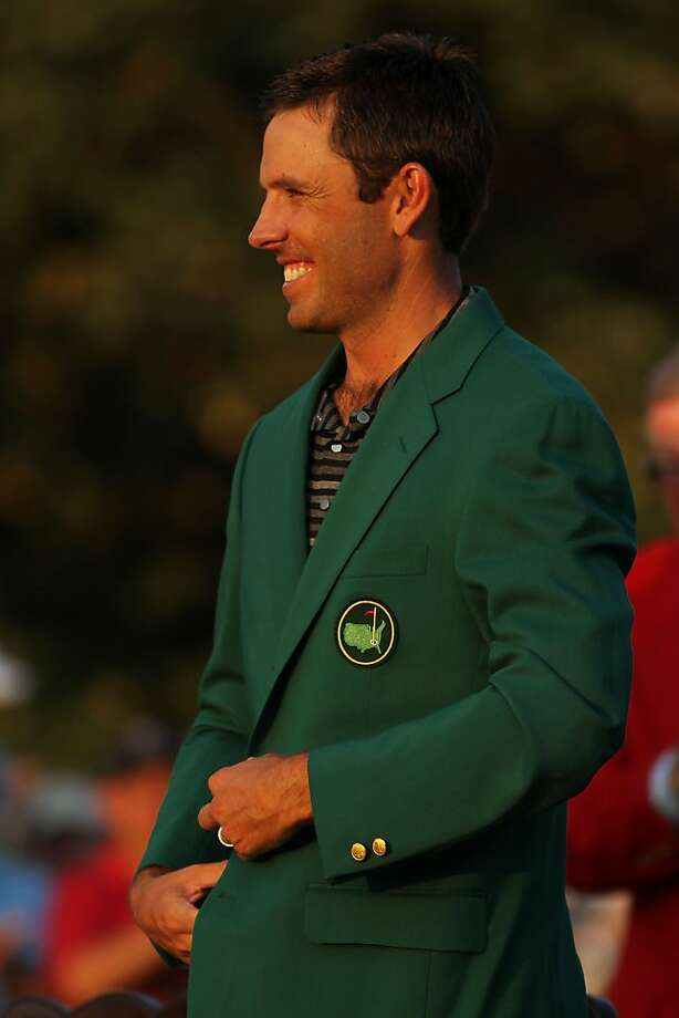 AUGUSTA, GA - APRIL 10:  Charl Schwartzel of South Africa smiles to the gallery at the green jacket presentation after his two-stroke victory at the 2011 Masters Tournament at Augusta National Golf Club on April 10, 2011 in Augusta, Georgia. Photo: Jamie Squire, Getty Images