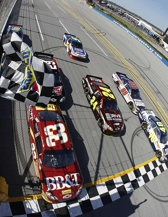 Jimmie Johnson (48) crosses the finish line slightly ahead of Clint Bowyer (33) to win the NASCAR Sprint Cup Series auto race at Talladega Superspeedway, Sunday, April 17, 2011, in Talladega, Ala. Photo: Todd Warshaw, AP