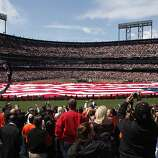 A larger-than-life American flag covers the infield during the Giants Opening Day ceremony at AT&T Park against the St. Louis Cardinals on Friday in San Francisco.