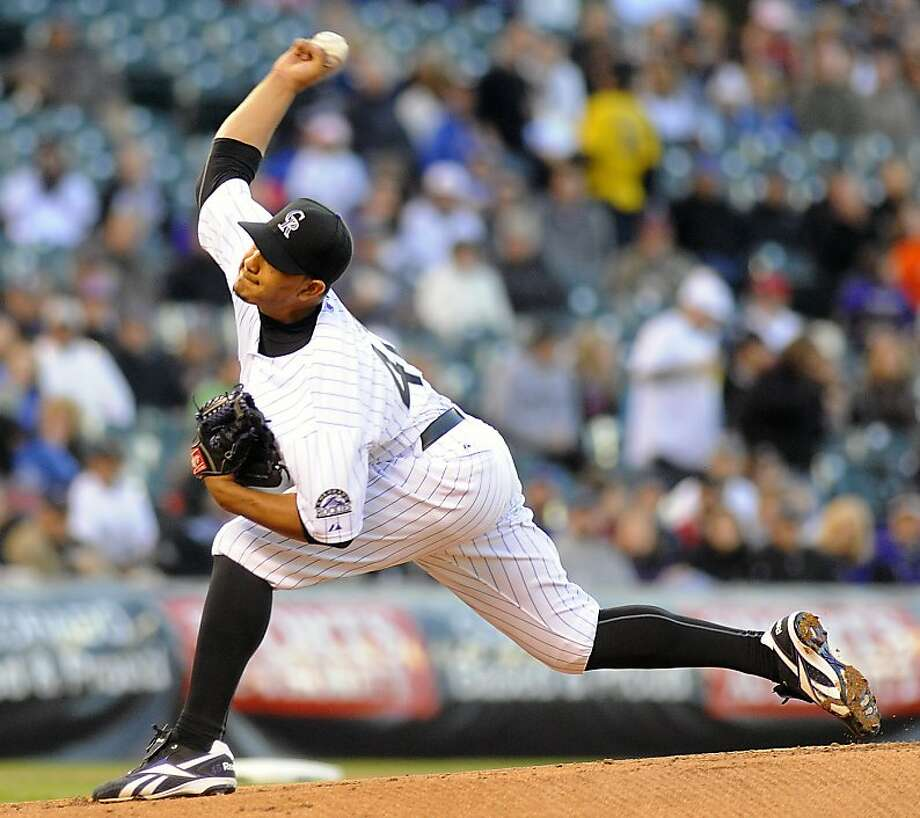 Colorado Rockies starting pitcher Jhoulys Chacin throws in the first inning of a baseball game against the Chicago Cubs at Coors Field in Denver on Friday, April 15, 2011. Photo: Chris Schneider, AP