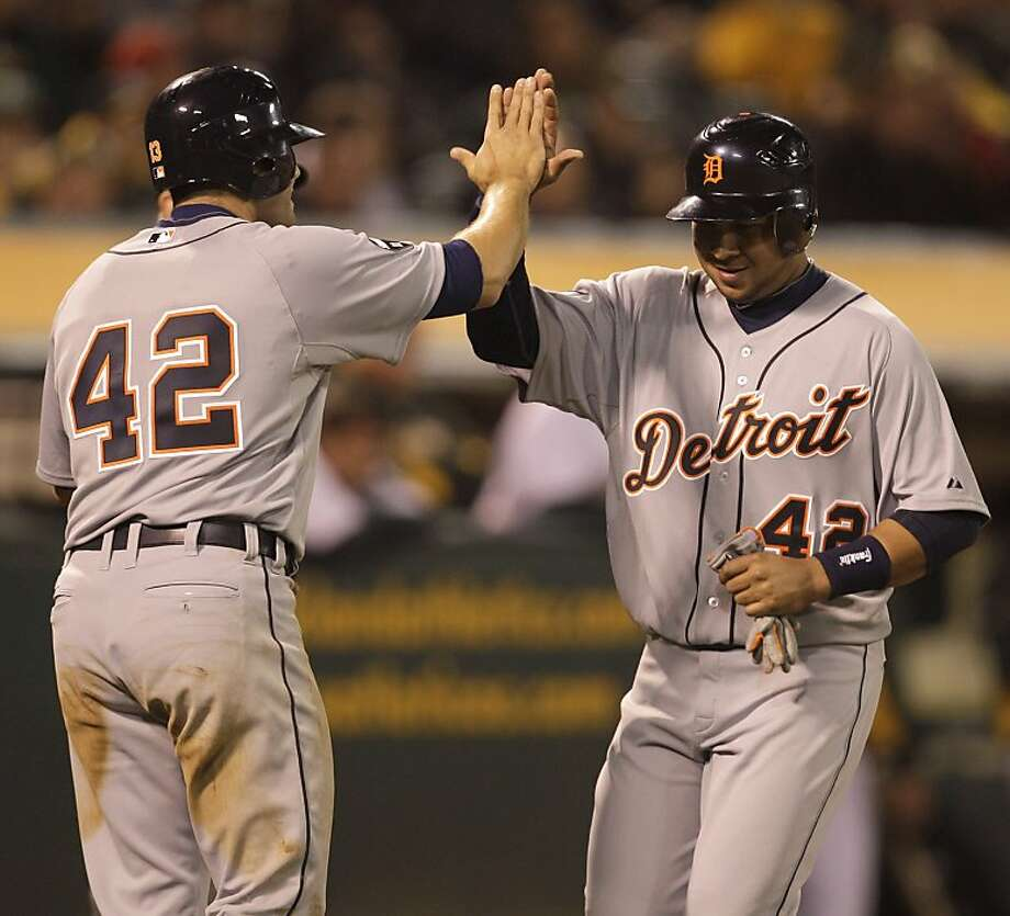 Detroit Tigers' Alex Avila, left, congratulates teammate Jhonny Peralta after both scored against the Oakland Athletics in the tenth inning of a baseball game Friday, April 15, 2011, in Oakland, Calif. Brennan Boesch's RBI double scored both Peralta and Avila. Photo: Ben Margot, AP