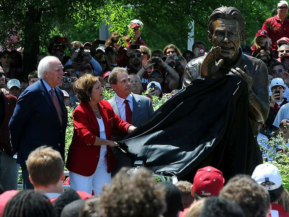 Terry Saban, the wife of Alabama head coach Nick Saban, pulls the cover form the newly completed statue honoring the 2009 National Championship season as Alabama athletics director Mal Moore looks on during the Nick Saban statue unveiling  at the University of Alabama Saturday April 16, 2011. Photo: Jason Harless, AP