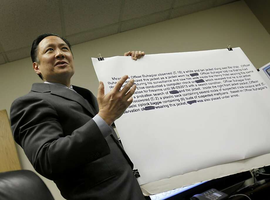 Public Defender Jeff Adachi held up a blow up of police reports that claim a suspect was wearing a coat where drugs were found.  A video shows the suspect was wearing a different coat. San Francisco Public Defender Jeff Adachi revealed another case involving officers from Southern Station where video contradicts police reports Monday March 7, 2011. Photo: Brant Ward, The Chronicle