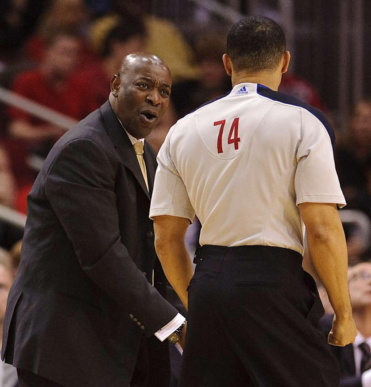 Golden State Warriors head coach Keith Smart, left, disputes a call with referee Curtis Blair (74) during the third quarter of an NBA basketball game against the Houston Rockets, Wednesday, March 23, 2011, in Houston. The Rockets beat the Warriors 131-112.
