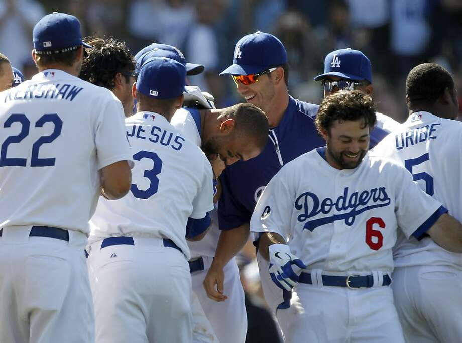 Los Angeles Dodgers' Matt Kemp, center, is mobbed at the plate after he hits a game winning two-run home run to beat the St. Louis Cardinals during the ninth inning of a baseball game in Los Angeles, Sunday, April 17, 2011. Dodgers won the game 2-1. Photo: Alex Gallardo, AP