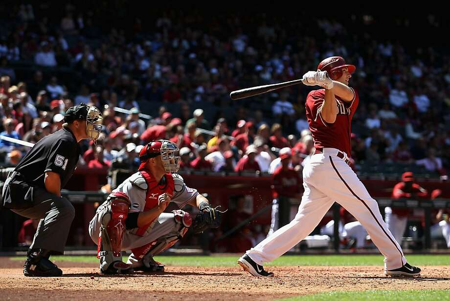 PHOENIX, AZ - APRIL 10:  Stephen Drew #6 of the Arizona Diamondbacks hits a RBI double against the Cincinnati Reds during the third inning of the Major League Baseball game at Chase Field on April 10, 2011 in Phoenix, Arizona. Photo: Christian Petersen, Getty Images
