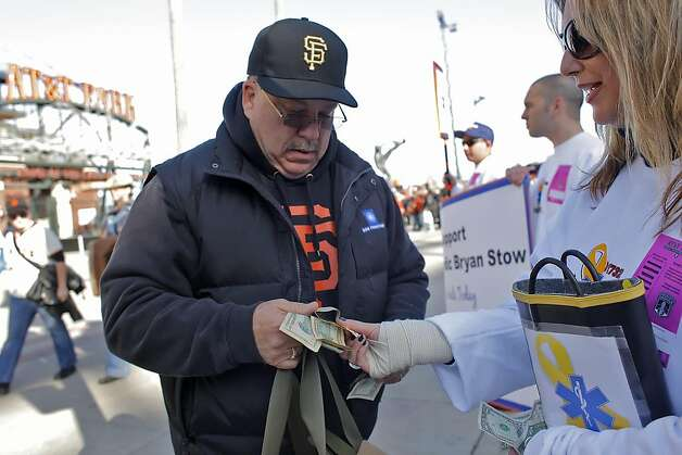 Gary Rossiter, left  gives a donation to Judy Stark, who is collecting for the  Bryan Stow fund, Monday April 11, 2011,before the Giants- Dodgers game in San Francisco, Calif.  Byran Stow was brutally  attacked at the Dodgers- Giants game , March 31 in Los Angeles. Photo: Lacy Atkins, The Chronicle