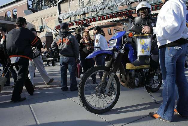 San Francisco Police Officer Bart Johnson watches the crowd as he talks with Shannon Nelson who was collecting funds for Byran Stow outside the gates at AT&T Park opened for the first Giants and Dodgers game,  Monday April 11, 2011, in San Francisco, Calif. Photo: Lacy Atkins, The Chronicle