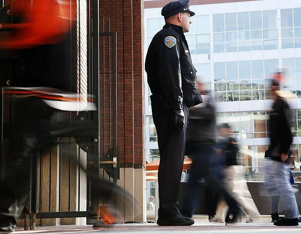 A San Francisco Police officer stands outside the doors to AT&T Park on Monday, April 11, 2011. There is increased security at the Giants vs. Dodgers game after Bryan Stow, a local paramedic, was beaten in Los Angeles post-baseball game. Photo: Anna Vignet, The Chronicle
