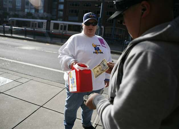 Trish Rhodes takes donations for Bryan Stow outside of AT&T Park on Monday, April 11, 2011. There is increased security at the Giants vs. Dodgers game in San Francisco on Monday, April 11, 2011. Photo: Anna Vignet, The Chronicle