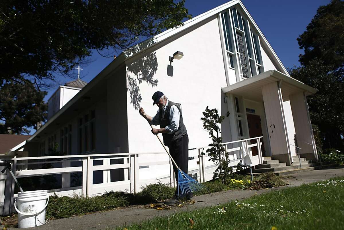 Mark Kroeger, Department of Public Works gardener, works in front of the Treasure Island Chapel on Monday, March 28, 2011 in Treasure Island, San Francisco, Calif.