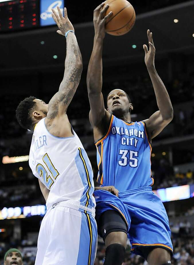 Oklahoma City Thunder forward Kevin Durant (35) goes up for a shot against Denver Nuggets forward Wilson Chandler (21) during the first quarter of an NBA basketball game Tuesday, April 5, 2011, in Denver. Photo: Jack Dempsey, AP