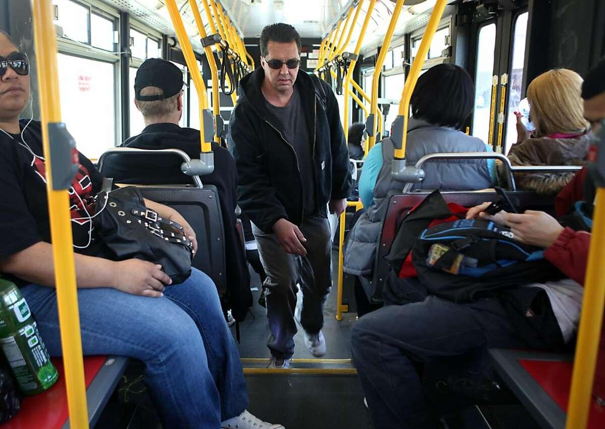 Passengers ride the 108 Treasure Island muni line on Wednesday, March 30, 2011 on Treasure Island, San Francisco, Calif.