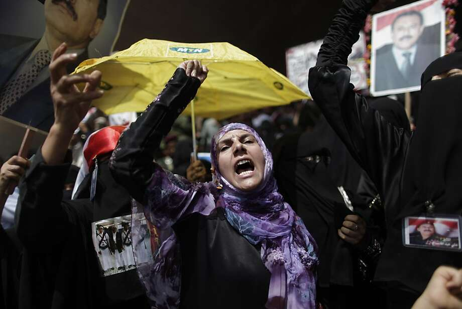 Female supporters of Yemeni President Ali Abdullah Saleh shout slogans during a rally supporting him, in Sanaa,Yemen, Friday, April 15, 2011. Photo: Muhammed Muheisen, AP