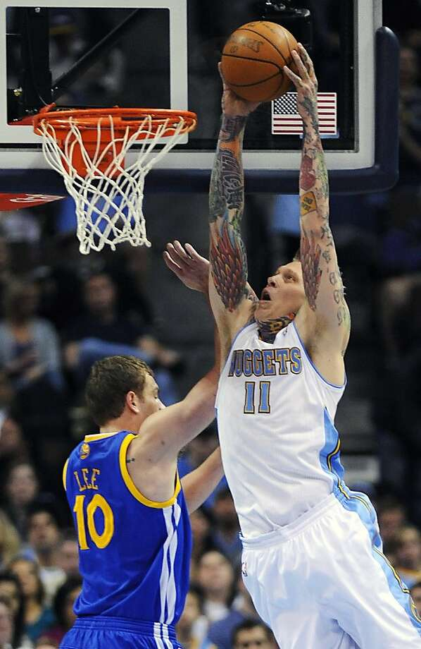 Denver Nuggets forward Chris Anderson dunks over Golden State Warriors forward David Lee in the first quarter of an NBA basketball game in Denver on Monday, April 11, 2011. Photo: Chris Schneider, AP