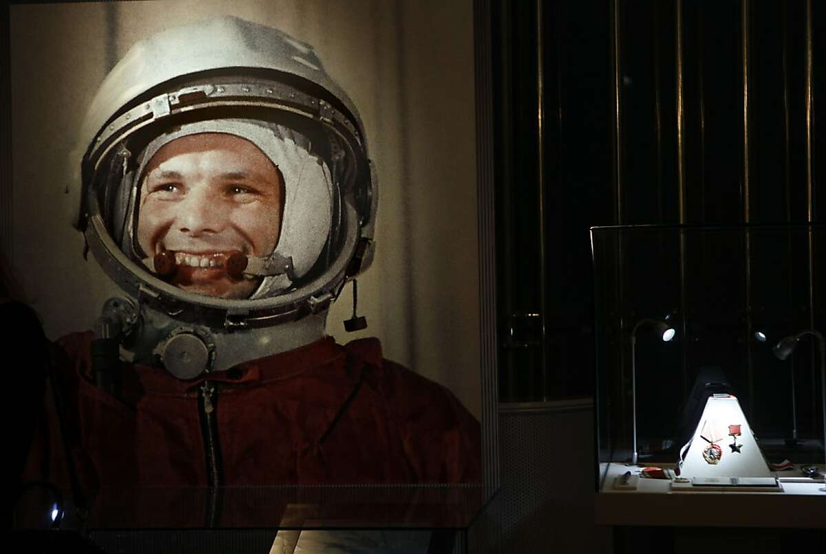 An undated portrait of the first man in space, Yuri Gagarin, and his award of the Hero of the Soviet Union, at right, part of an exhibition dedicated to the 50th anniversary of the first man in space, in Moscow, Russia, Monday, April 11, 2011.