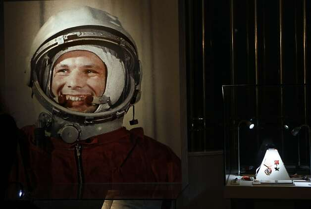 An undated portrait of the first man in space, Yuri Gagarin, and his award of the Hero of the Soviet Union, at right, part of an exhibition dedicated to the 50th anniversary of the first man in space, in Moscow,  Russia, Monday, April 11, 2011. Photo: Alexander Zemlianichenko, AP