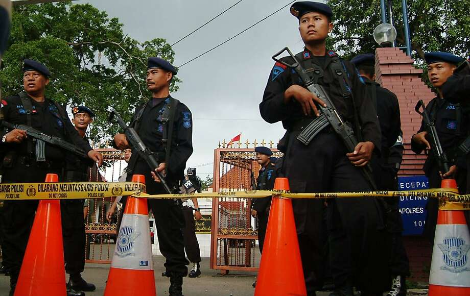 Indonesian Mobile Brigade policemen stand guard outside a police station where a suspected suicide bomber blew himself up during Friday prayers in Cirebon on April 15, 2011. Several people were wounded in a suspected suicide bomb attack during Friday prayers at an mosque in a police compound in Indonesia's West Java province, reports said quoting police. Photo: Str, AFP/Getty Images
