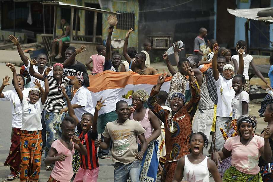 Local residents take to the street to celebrate the capture of Laurent Gbagbo, in the Youpougon neighborhood of Abidjan, Ivory Coast, Monday, April 11, 2011. The French Embassy in Ivory Coast said strongman Laurent Gbagbo was captured Monday by forces ofdemocratically elected leader Alassane Ouattara. Photo: Rebecca Blackwell, AP