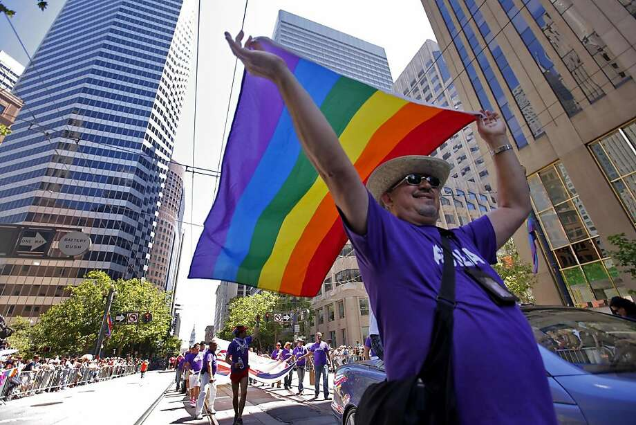 Al Valez flies his flag, which is 35 years old, as he marches in the 40th annual Gay Pride Parade on Sunday in San Francisco. Photo: Lacy Atkins, The Chronicle