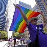 Al Valez flies his flag, which is 35 years old, as he marches in the 40th annual Gay Pride Parade on Sunday in San Francisco.