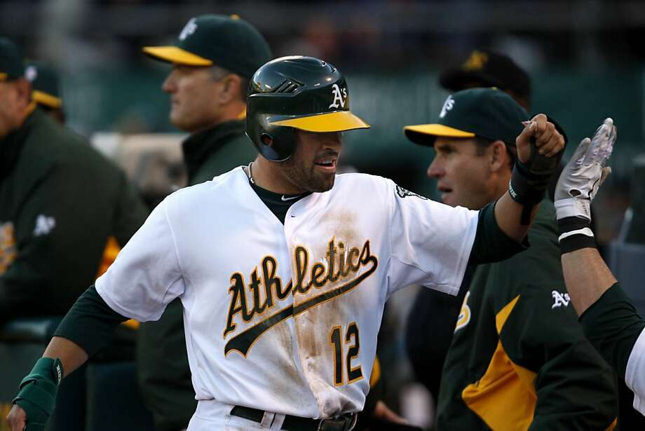 Oakland A's David DeJesus celebrates after a run during the 4th inning. As the Oakland Athletics take on the Detroit Tigers at Oakland-Alameda County Coliseum in Oakland, Calif., on Saturday, April 16, 2011. Photo: Thomas Levinson, The Chronicle