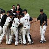 The Giants' Aaron Rowand is greeted by his teammates after his game-winning hit in the 12th inning that allowed Nate Schierholtz to score, beating the St. Louis Cardinals on Friday.